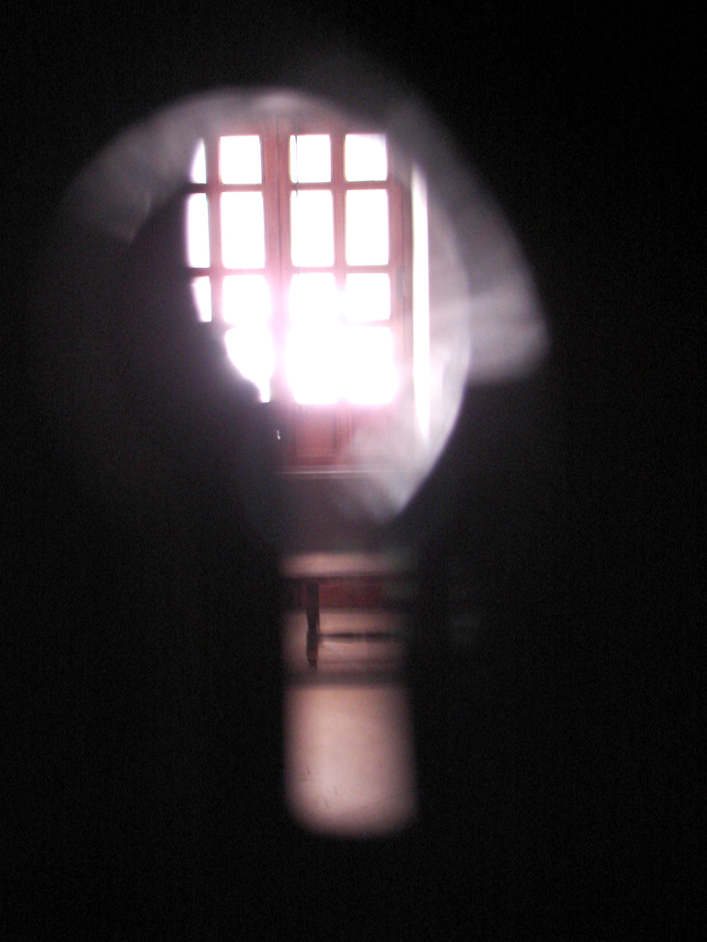 Through the keyhole.