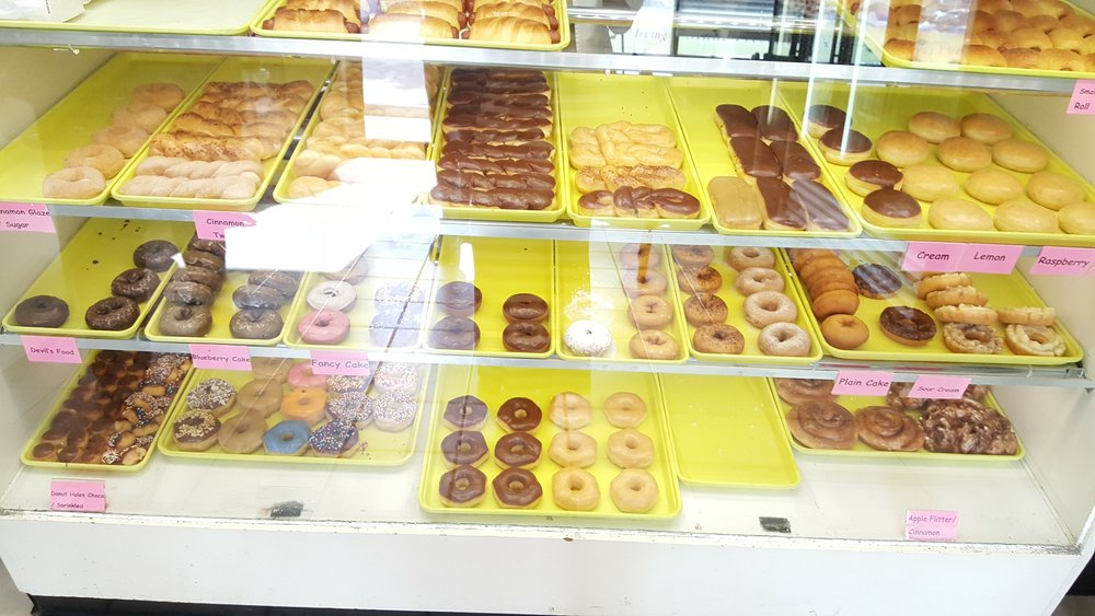 """There's something that's so nostalgic for me going into one of these old school doughnut shops in Dallas whenever I go home. Cheap, good, always fresh, no gimmicks just """"Donuts"""" like the sign implies."""