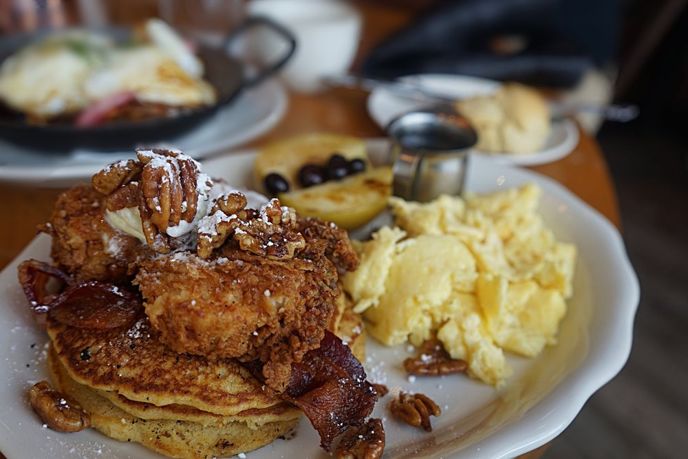 You think Chicken 'n' Waffles are good?  Try Sweet Potato pancakes with Fried Chicken and bacon!   Shoo Mercy Sweet Potato Pancakes. buttermilk fried chicken. apple cider bacon. spiced pecans.