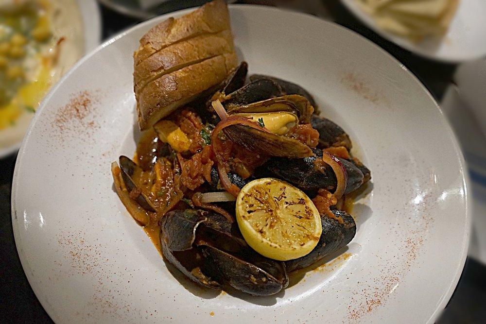 Mediterranean Mussels. tomato-charmoula sauce. garlic.
