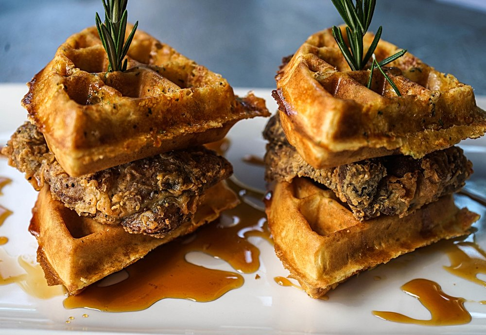 Chicken & Waffle. (featured on the Sunday Brunch Menu)   rosemary. cheddar malted waffle. crispy chicken. thighs, sorghum maple syrup.