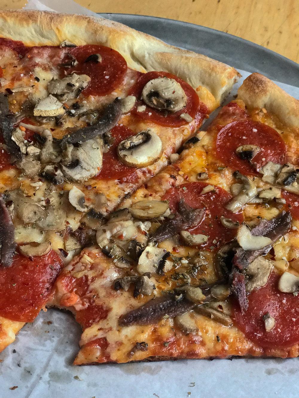 Custom. peperoni. mushroom. anchovies.