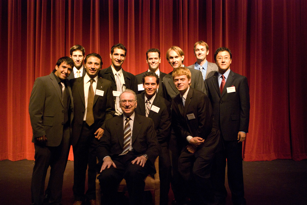 (Pictured above are : Sitting: Dr. Irwin Jacobs, front row, left to right: Dany Kitishian, Remi Raphael, John Yamauchi, Tom Cohen; back row, left to right: Kurt Klassen, Saleh Amirriazi, Ned Sahin, Jason Steiner, Richard Woodbridge, Mike Song)