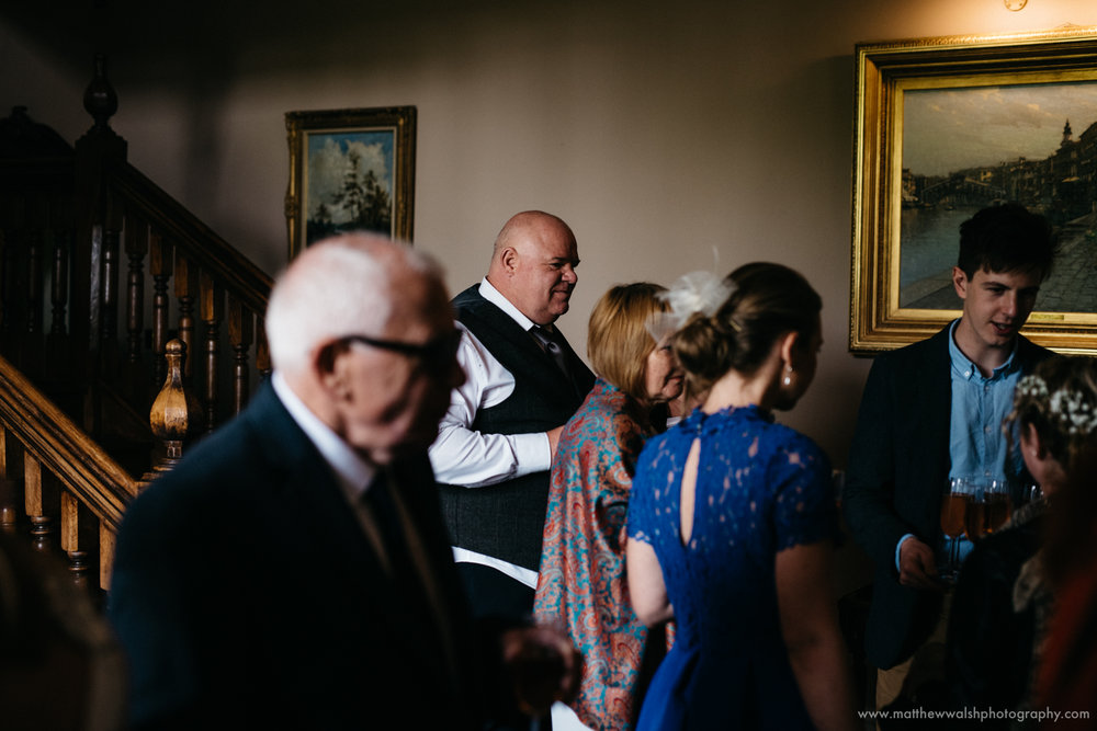 Family and friends gather after the ceremony for drinks in the venues hall