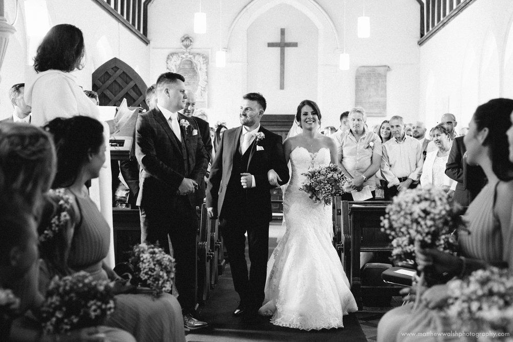 The brother of the bride in a heart felt moment as he leads his sister down the isle