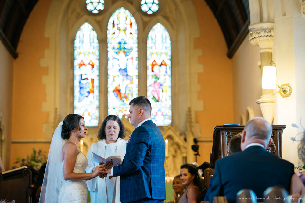 An emotional time as the bride and groom make their vows before the church alter