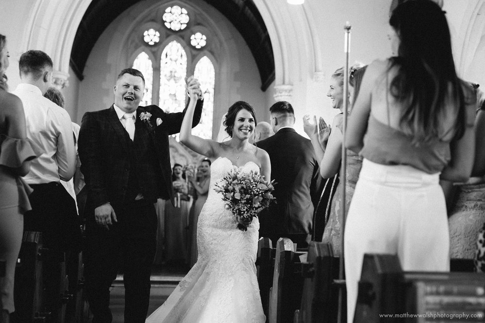 Bride and groom celebrate as the walk down the isle