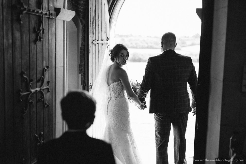 Bride and groom leaving there church into the sunlight