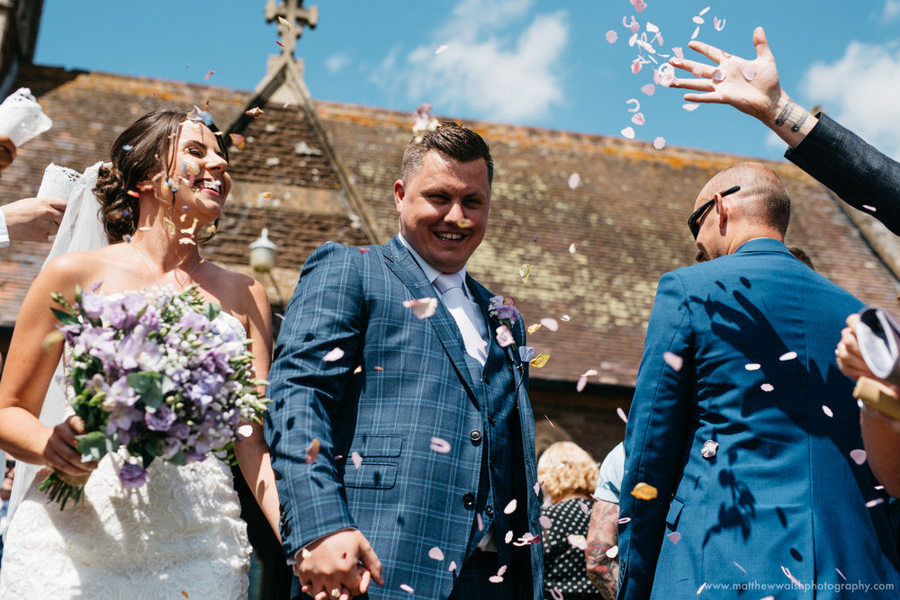 Bride and groom showered with confetti in a perfect moment
