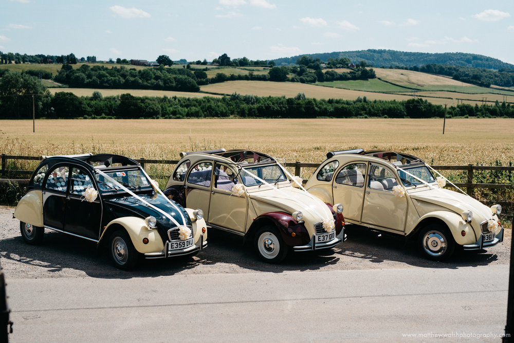2Cv Wedding cars lined up outside the church