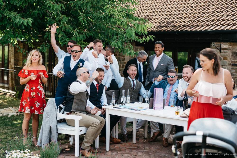 Guests celebrate as England score during a documentary style unposed photograph