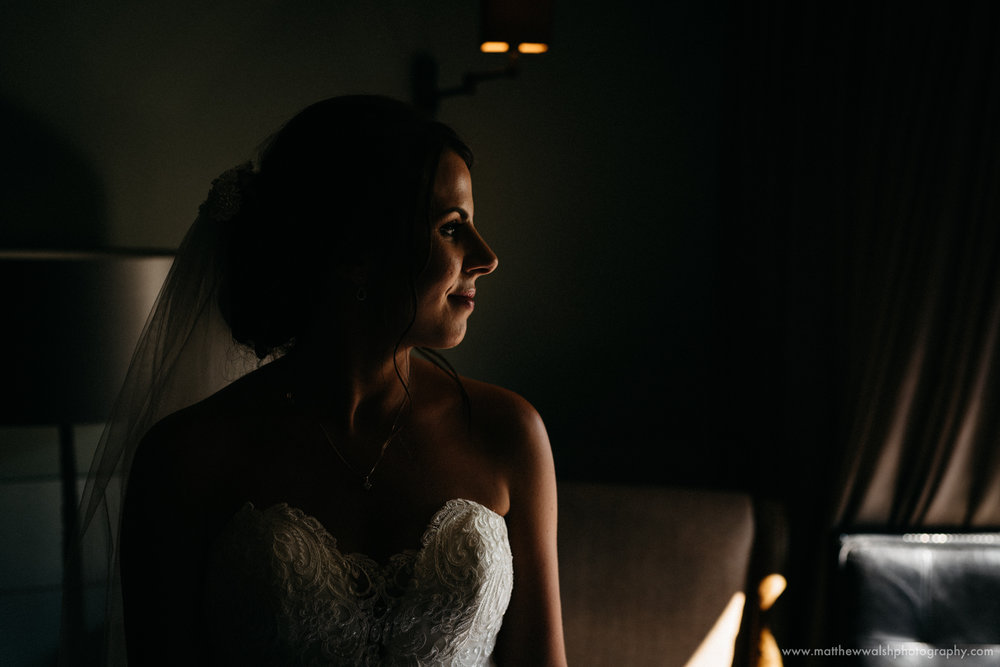 The bride in a pocket of natural light