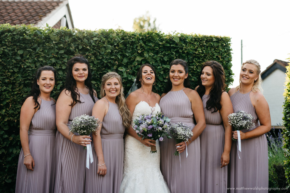 Bridesmaids post for a photograph