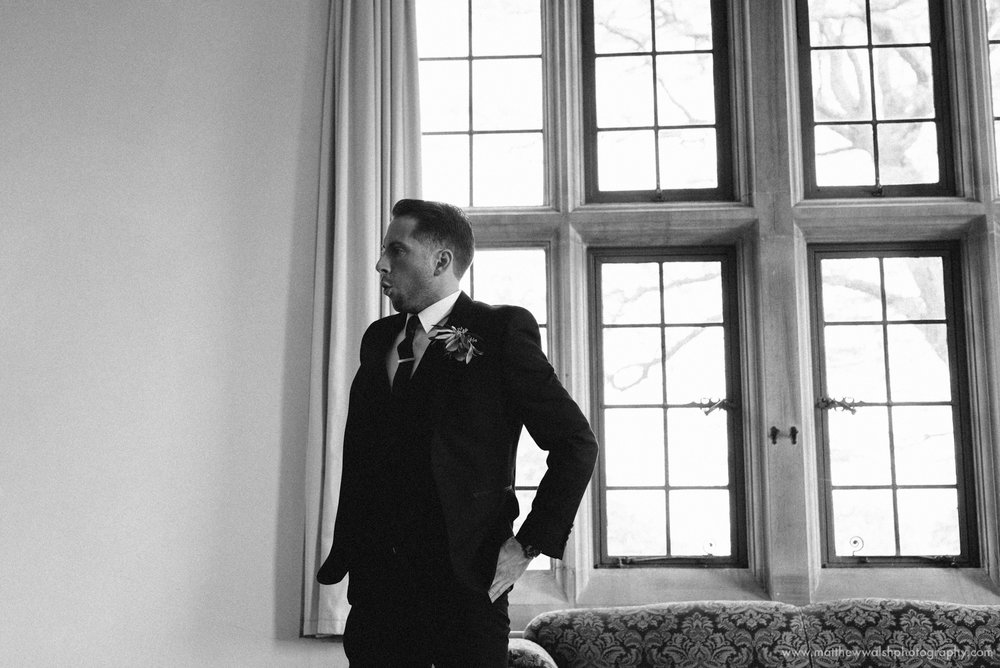 Pre ceremony nerves as the groom exhales after having his picture taken
