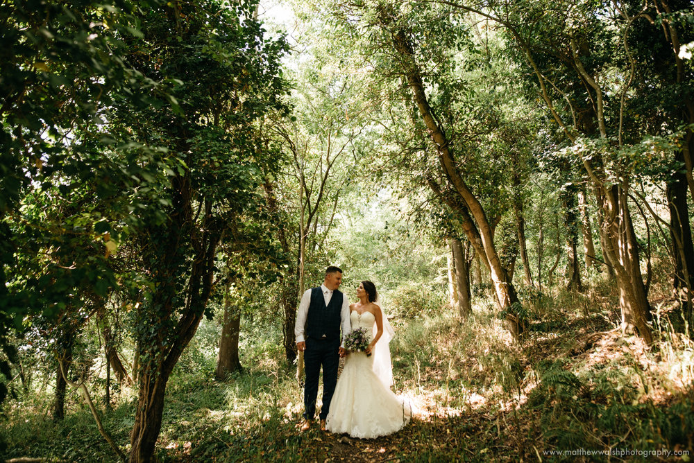 A quiet moment in the woods with the happy couple