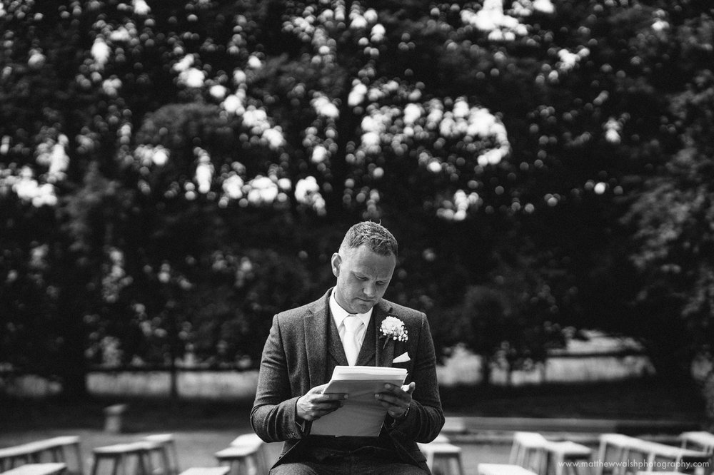 The groom taking time out to rehearse his speech