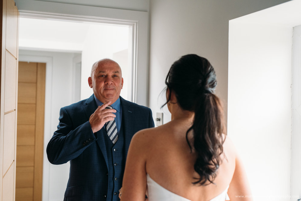 Seeing your daughter in her wedding dress for the first time must be a very special moment