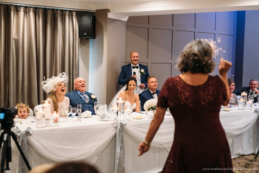 Big laughs during the speeches as the best man puts a plan into place