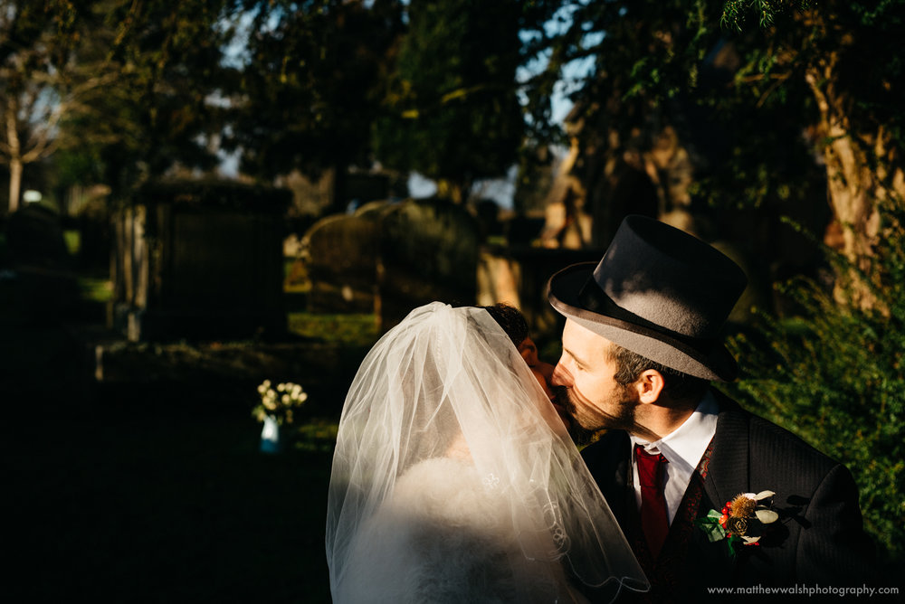 a kiss after the ceremony in the natural winter light