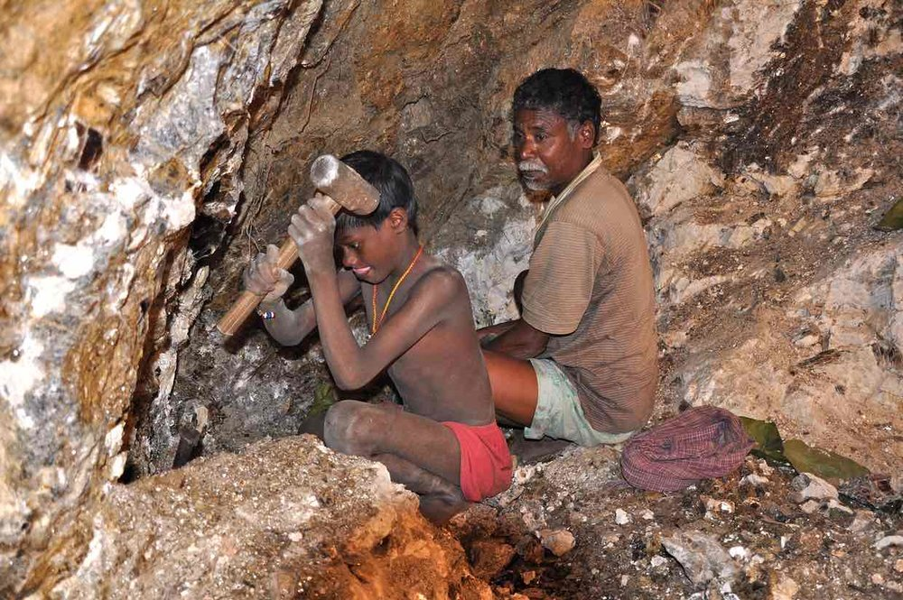 From 2013, seven-year-old Karulal works with his father in a mica mine. -- The Guardian, Peter Bengtsen
