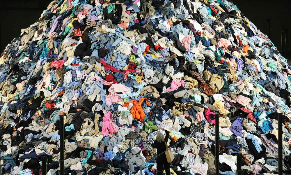 French artist Christain Boltanski's 'No Man's Land', was made of 30 tons of discarded clothing. Britain alone is expected to send 235m items of clothing to landfill this spring. -- The Guardian.
