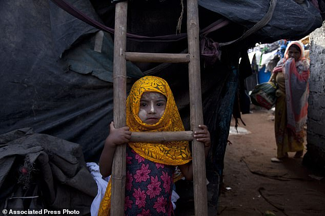 1366569-4897570-A_Rohingya_Muslim_girl_Yasmin_Ara_stands_in_front_of_her_shanty_-a-1_1505850699008.jpg
