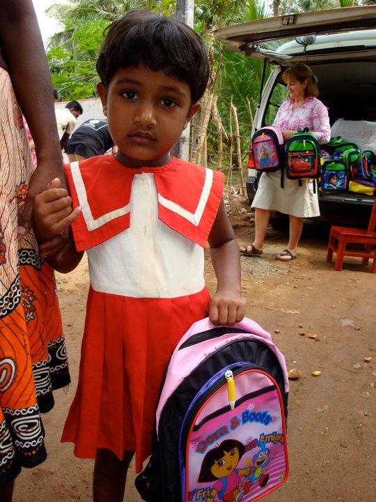 Annemarie in the background getting stuck into the school bags for the pre-schoolers! This little girl is at our 1st Pre-school