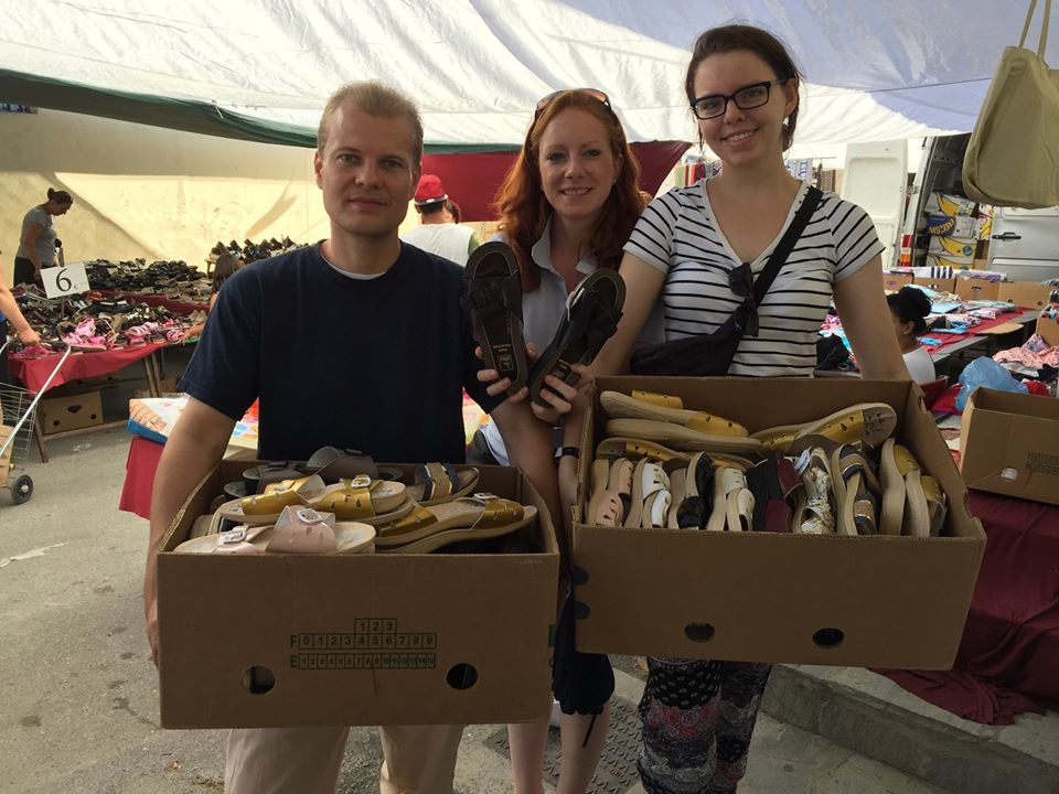 Daniela with her husband Malte and volunteer Leah buying shoes in the Saturday Bazzar