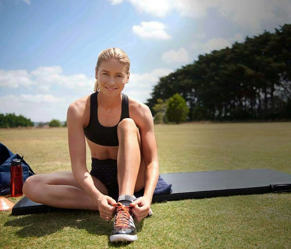 Eleanor Patterson sat on a yoga mat in the park, in the sunshine, tying her shoe laces