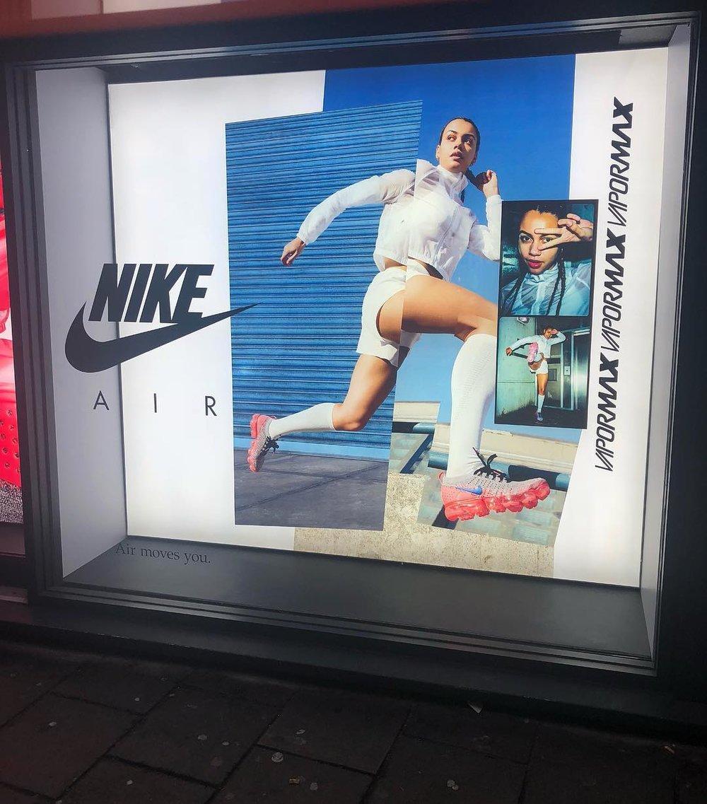 Ocean Lewis advert in the window of a Nike store