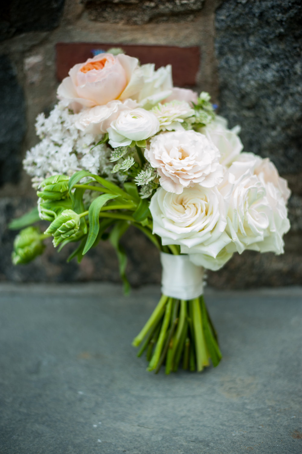 bridal bouquet with pale peach peonies.jpg