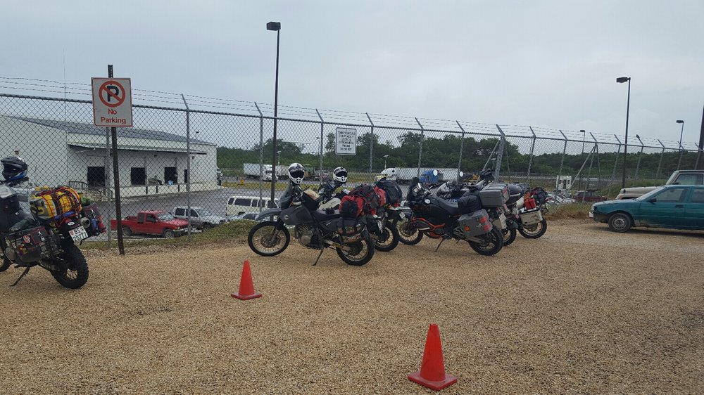 Motorcycle parking at Belize customs.