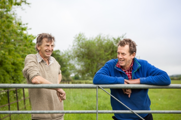John, pictured left, on his farm in Hertfordshire