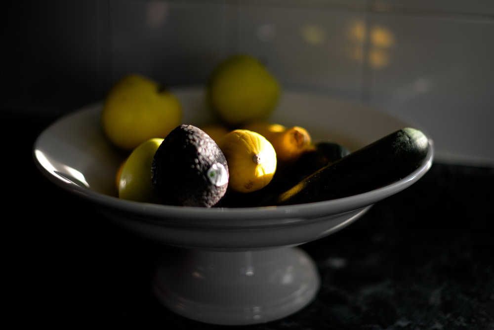 fruit and vegetables in a white bowl