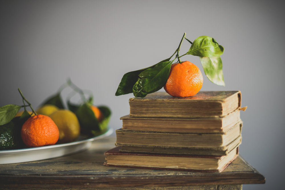 old books and oranges
