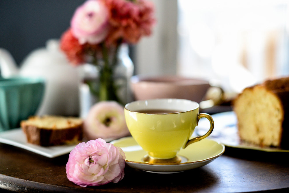 yellow teacup and pink flower