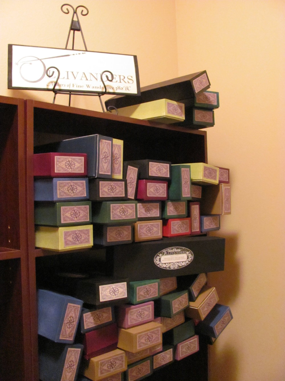 We purchased 100 long business card boxes ... and painted each and every single one! This took a long time. Like a really long time. And then they needed the proper labels to make the Ollivander's wand boxes complete.