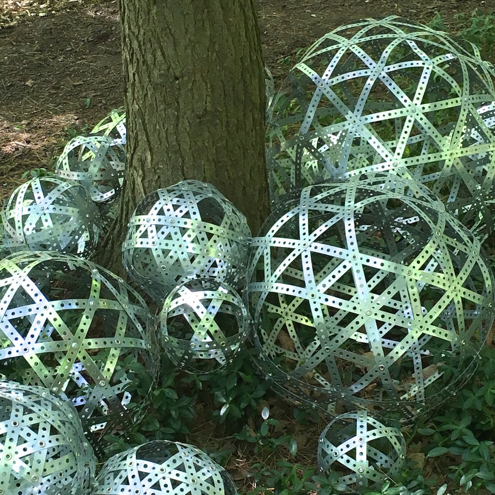 Metheny_%22Trees and Spheres%22 (Detail)2017_Perforated metal strapping, grommets, screws_ 36%22H x 216%22W x 216:D.jpg