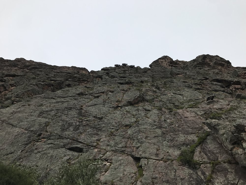 Those small little bumps at the top of the rock wall are the Skylodge sleeping pods.