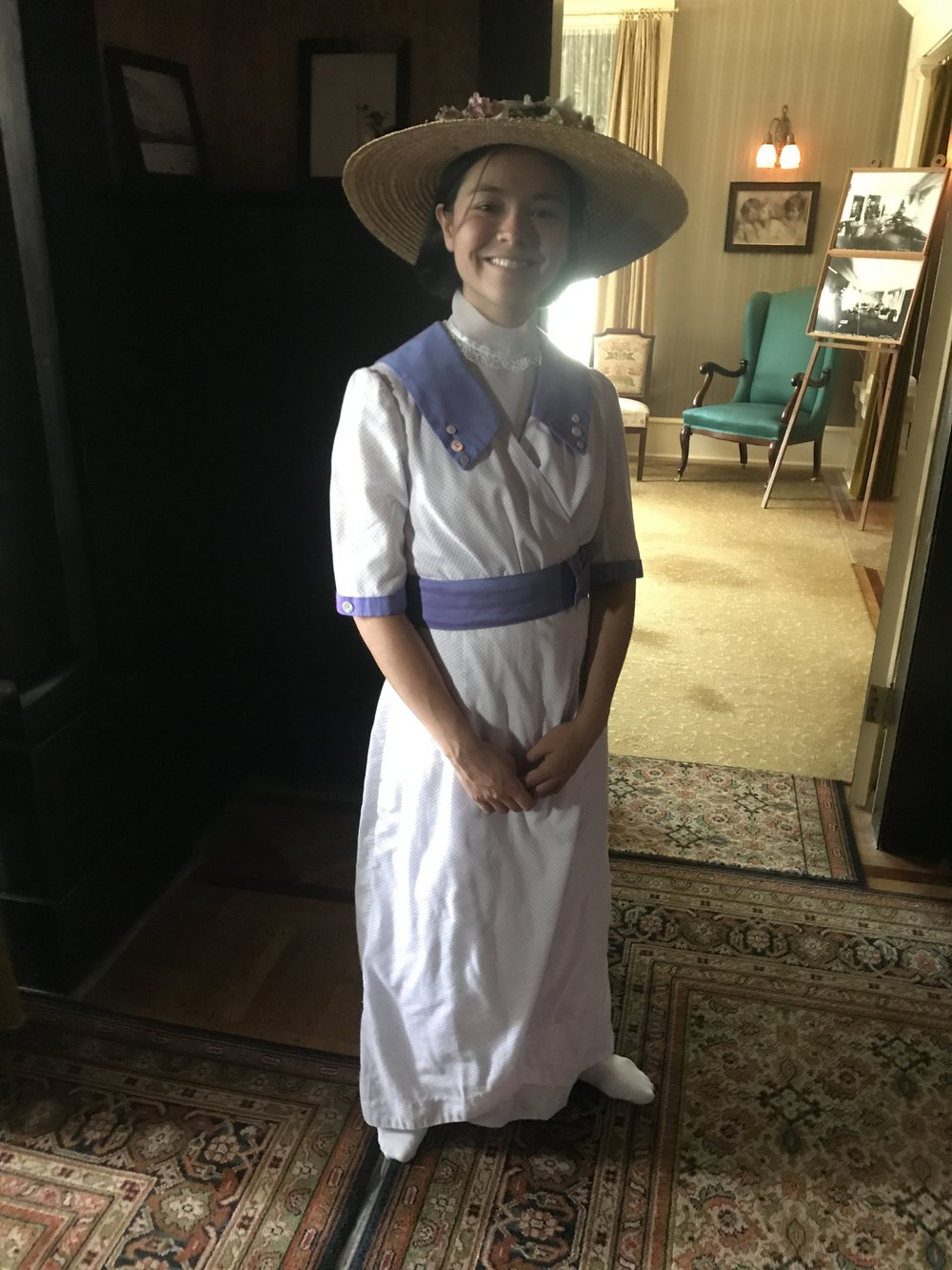 Parks Canada employee dressed like the lady of the house 100 years ago.