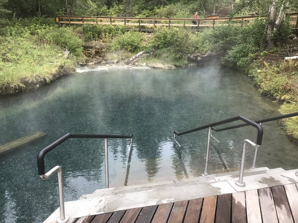 Boiling hot sulfur rich mineral water bubbles up from the rock formation in the corner and gradually flows through this pool to the one below.