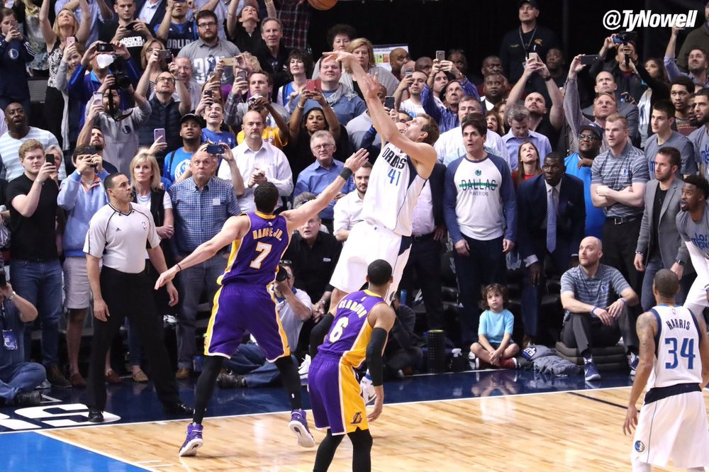 Dirk hits his signature fadeaway on Larry Nance Jr. Photo by Ty Nowell.