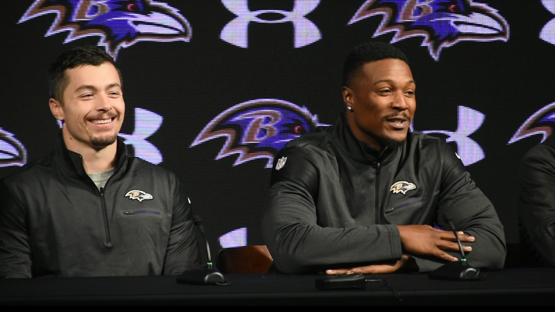 Jefferson and fellow Ravens acquisition Danny Woodhead meet the Baltimore press.     (alternate caption: Two hostages talk to their rescuers for the first time since liberation)