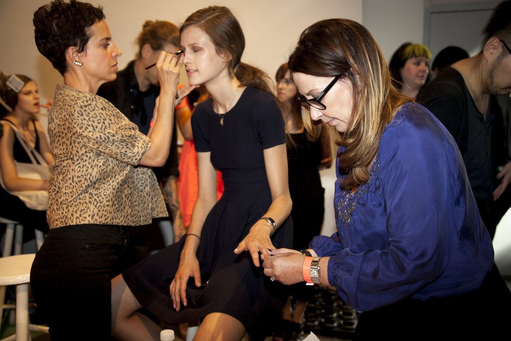 Deborah giving a manicure backstage at NYFW