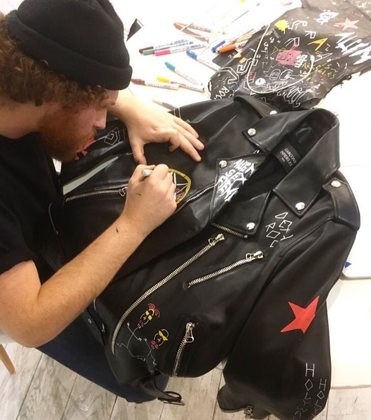 Jordan, the graphic designer, painting a leather jacket