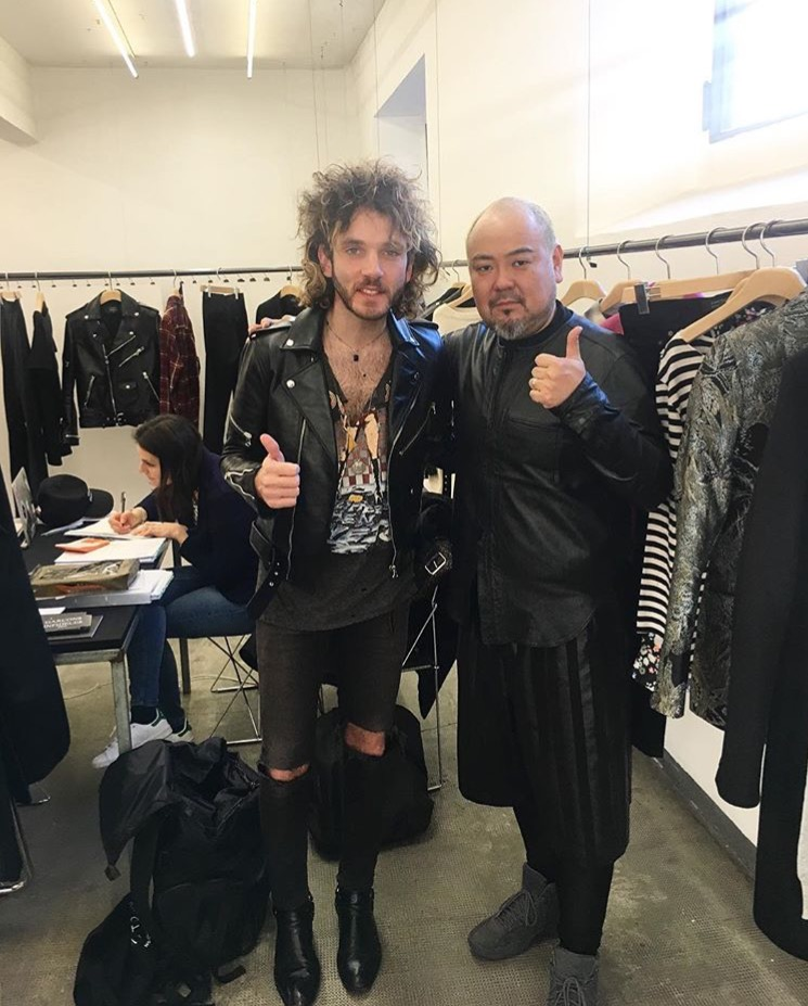 Adrien Albou with the first customer, Isetan