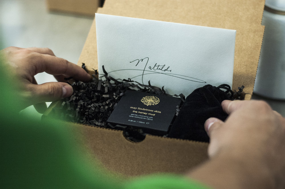 Carefully packing the online orders complete with a signed note!