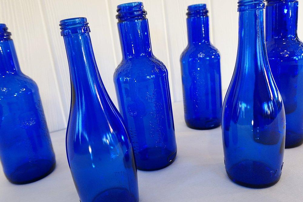 Assorted Cobalt Blue Bottles