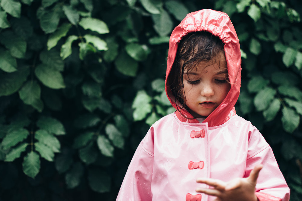 child in rain jacket in south florida