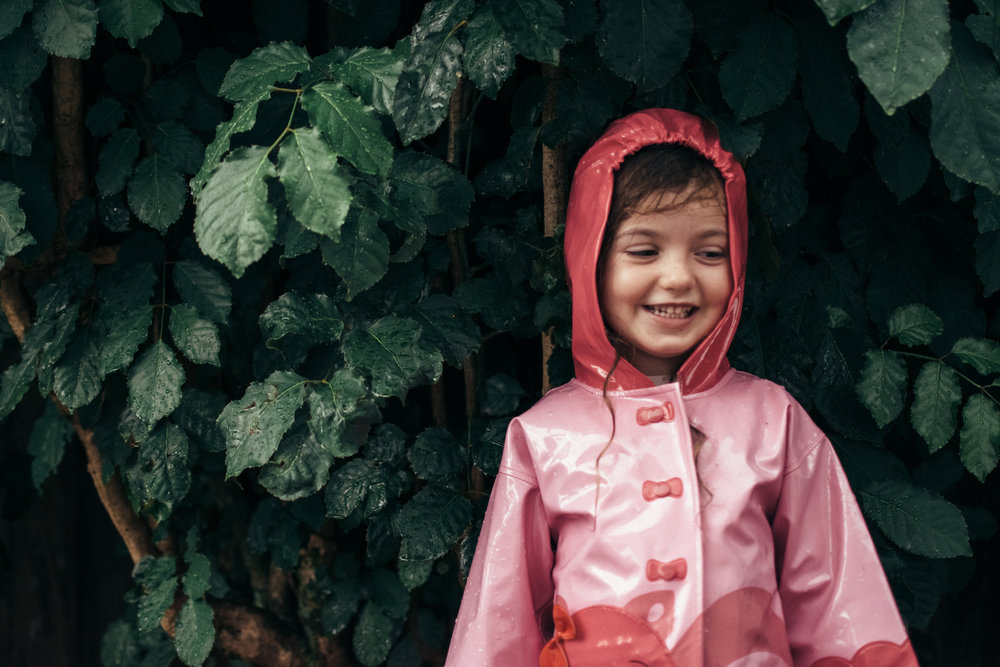 child smiling in the rain in south florida